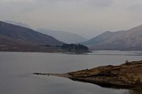 Small strip of land projecting into a Loch and rugged outdoors i