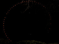 Outline of the big wheel of the London eye at night