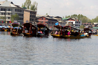 Multiple families relaxing in multiple Shikaras in the Dal Lake