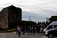 A whole mass of tourists inside Edinburgh Castle, descending fro