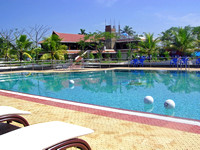 Pool with balls, and cottages in the resort in Alleppey, Kerala,