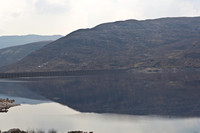 Loch and reflection of hills in the Scottish Highlands