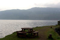 Wooden table and chairs at the shore of Loch Ness in Scotland