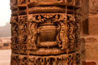 A stone pillar with beautiful carvings inside the Qutub Minar complex