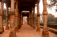 Artistic pillars are all that remain of this old monument inside the Qutub Minar Complex