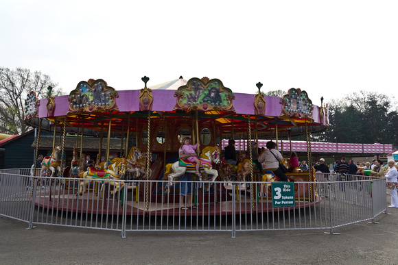 Children and adults at the Merry go round inside the Blair Drumm