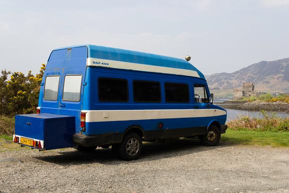 Caravan parked at side of highway near Eilean Donan Castle in Scotland