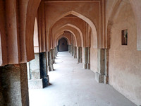 Archways, pillars and the long corridor of an old Baoli in Mehrauli in Delhi