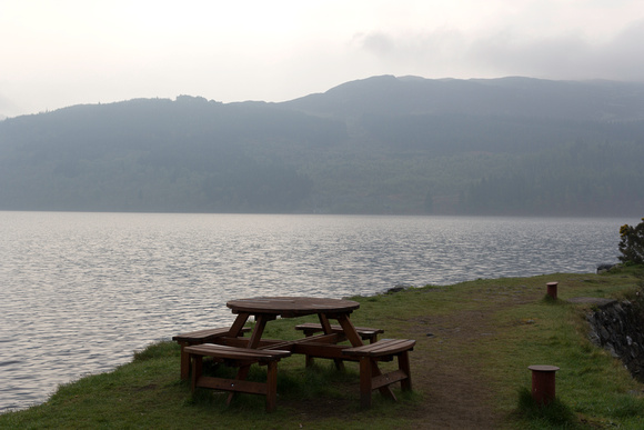 Ashish Agarwal: Scotland &emdash; Wooden table and chairs at the shore of Loch Ness in Scotland