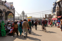 Devotees in a crowded street walking towards the Golden Temple i