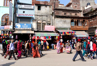 Shops and crowded street in front of the Golden Temple in Amrits