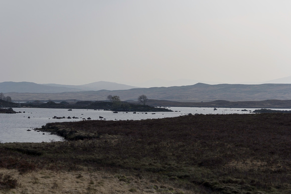 Rugged part of the Scottish Highlands with a water body and small hills